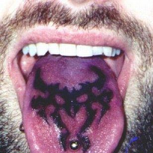 Tongue blackwork tattoo