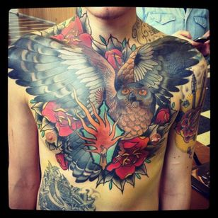Amazing chest piece done by Alix Ge Tattoo.
