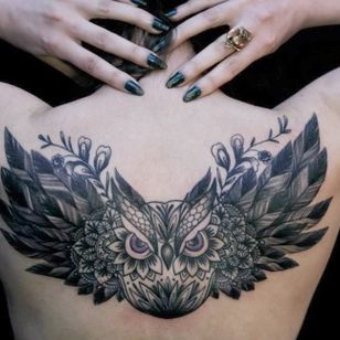 Backpiece tattoo by Dodie.