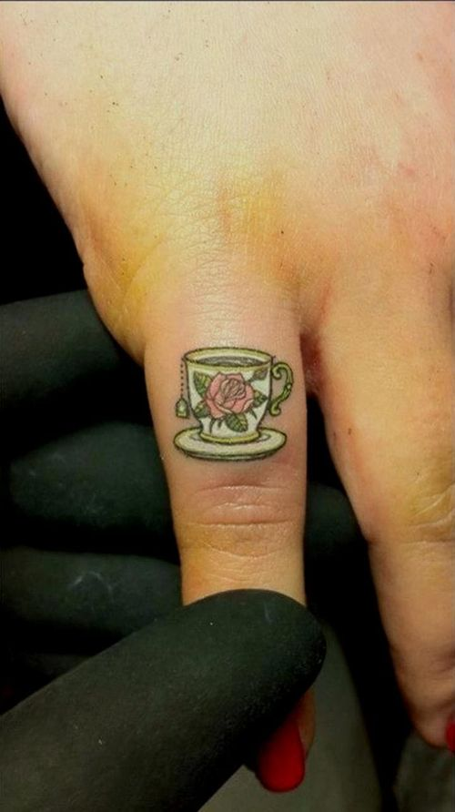 A common place to get a detailed small-piece tattoo are on the fingers. Looks so cute! Tattoo by Jorge Becerra.