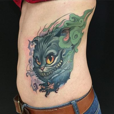 Tattoo by Turyanskiy. #cheshirecat #aliceinwonderland