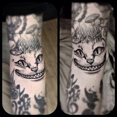 Cheshire cat tattoo by Michael Graham. #cheshirecat #aliceinwonderland #blackandgrey
