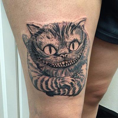 Tattoo by David Mushaney. #cheshirecat #aliceinwonderland
