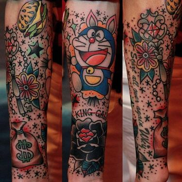10 Nostalgic Tattoos of Doraemon, the Wish-Granting Animé Cat