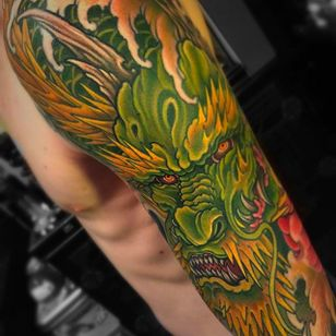 Beautiful and vibrant dragon sleeve tattoo by Chris Crooks. #chriscrooks #dragon #japanesetattoo #japanese #japanesestyle #dragonsleeve