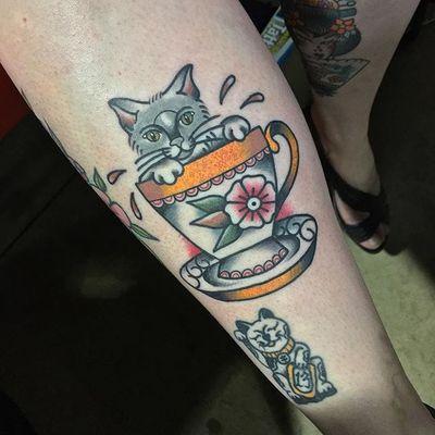 Cat in a tea cup tattoo by Chris Jenko. #traditional #tea #teacup #cat #feline #ChrisJenko