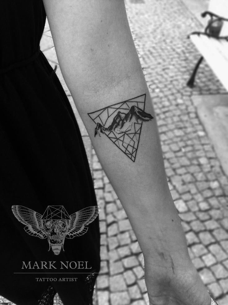 Tasteful geometric mountain tattoo piece by Mark Noel. #mountain landscape #geometric #MarkNoel