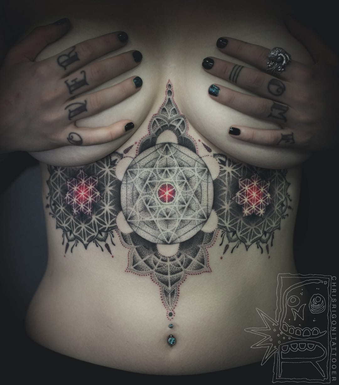 Fascinating sacred geometry underboob tattoo by Chris Rigoni...