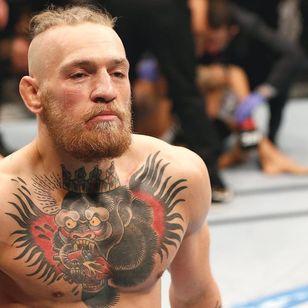 UFC fighter Conor McGregor rocking his old school gorilla chest piece