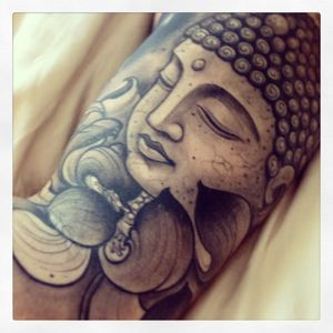 Buddha face with lotus.