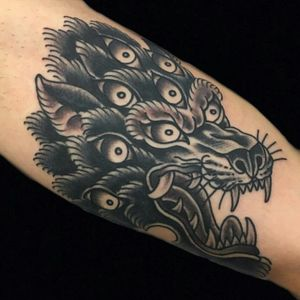his wolf has more than one eye on you! By our very own big bad wolf, andreafurci #tradworkers#london #wolftatto #eastlondontattoo #wolf #londontattoo #animaltattoos #besttraditionaltattoos #blackworktattoo #oldlines #shoreditch