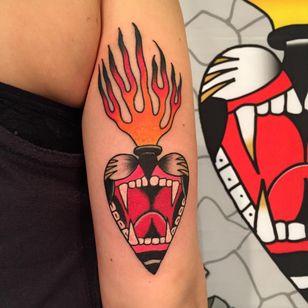 Roar of devotion. Tattoo by Max Newton #maxnewtown #sacredhearttattoo #color #traditional #heart #jaguar #roar #cat #fangs #fire #love