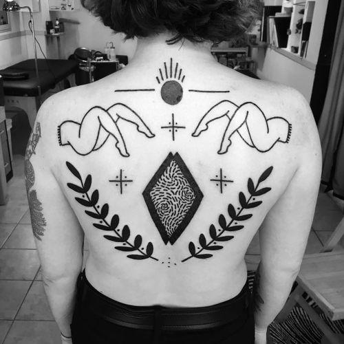 Stunning back piece tattoo by Meg Tuey #MegTuey #blackwork #linework #dotwork #sun #leaves #floral #legs #lady #backpiece #symbol #tribal #ornamental #folktraditional