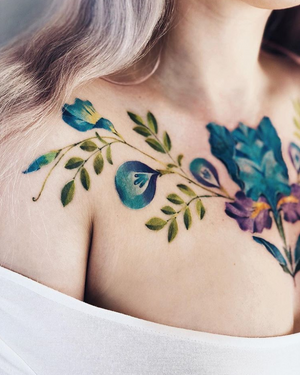 By Pis Saro #flower #floral #chesttattoo #color