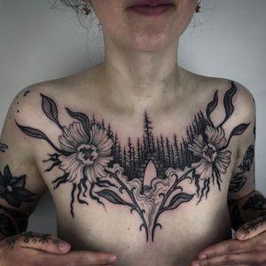 Tattoo by Noel'le Longhaul #NoelleLonghaul #pridemonth #pride #lgbtq #trans #chestpiece #illustrative #flowers #nature #forest