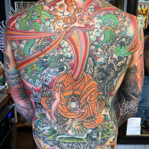 In death we become skeletons of enlightenment. Tattoo by Chad Koeplinger #chadkoeplinger #surrealtattoos #color #traditional #tibetan #Japanese #mashup #collage #dragon #skulls #buddha #sheel #tiger #landscape