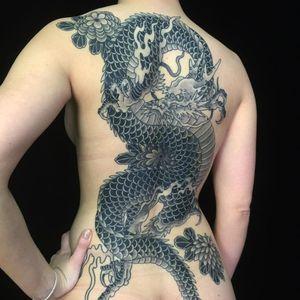 Tattoo by Sergey Buslay #SergeyBuslay #tattoodoambassador #Japanese #irezumi #blackandgrey #dragon #flowers #mums #floral #fire #folklore #mythicalcreature