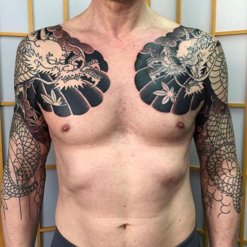 Tattoo by Sergey Buslay #SergeyBuslay #tattoodoambassador #Japanese #irezumi #dragon #chestpiece #mapleleaves #coveruptattoo #coverup #clouds #leaves #mythicalcreature #folklore