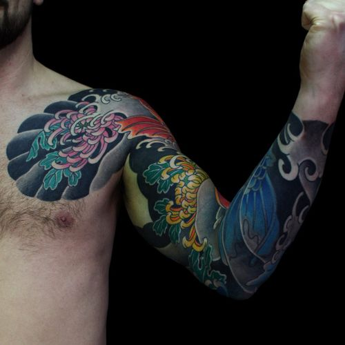 Tattoo by Sergey Buslay #SergeyBuslay #tattoodoambassador #Japanese #irezumi #waves #koi #fish #chrysanthemum #flower #floral #leaves