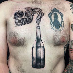 Tattoo by Monkey Bob Tattoo #Monkeybob #favoritetattoos #blackwork #illustrative #skull #death #bottle #glass #smoke #alcohol #drink