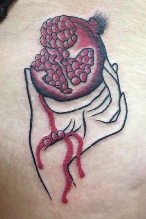 Minimalist hand, holding pomegranate