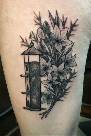 Birdfeeder and flowers tattoo #blackwork #flower