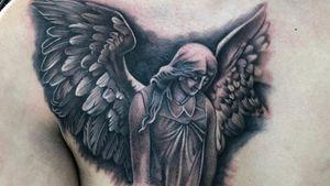 Angel tattoo #blackandgrey #realism #statue #angel #wings #femaletattooartist