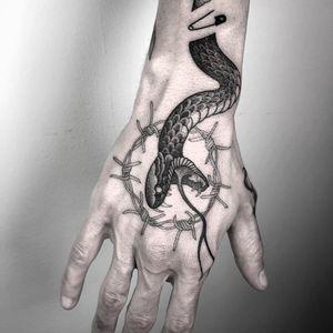 Tattoo by Nathan Kostechko #NathanKostechko #favoritetattoos #snake #blackandgrey #barbedwire #reptile #fangs #safetypin #animal #handtattoo