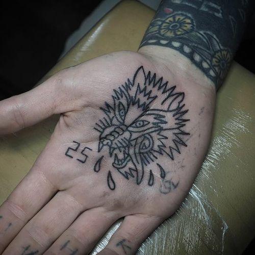Tattoo by Nixon #Nixon #nixontattooer #palmtattoos #blackwork #linework #palm  #illustrative #severedhead #wolf #dog