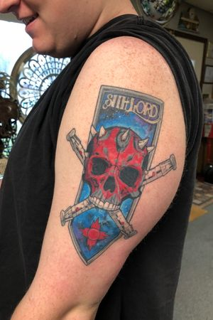 Sithlord-  this was his first tattoo