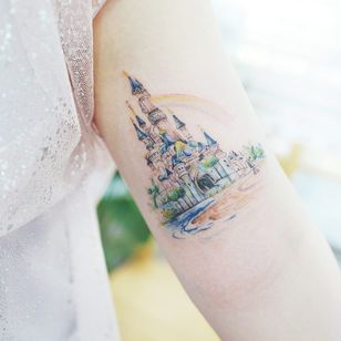 Tattoo by Banul #Banul #landscapetattoos #color #watercolor #fineline #linework #painting #Disney #castle #rainbow #fairytale