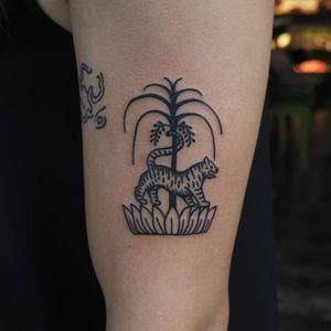 Tattoo by Or Kantor #OrKantor #junglecattattoos #linework #cat #tiger #Thai #lotus #flower #India #tree #illustrative #simple