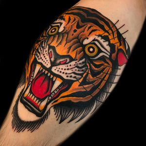 Tattoo by Becca Genne-Bacon #beccagennebacon #junglecattattoos #color #traditional #tiger #cat #roar #junglecat #fangs