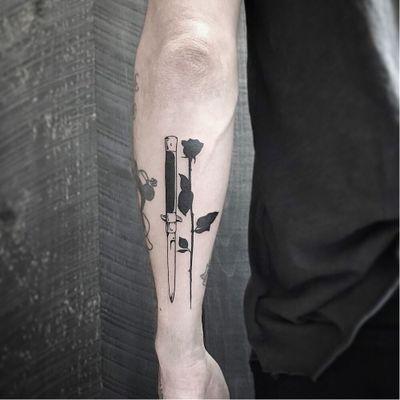 Tattoo by Welfare Dentist #WelfareDentist #daggertattoos #blackwork #dagger #knife #switchblade #rose #flower #silhouette #thorns