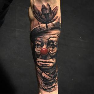 Tattoo by Alberto Escobar #AlbertoEscobar #clowntattoos #blackandgrey #redink #realism #realistic #hyperrealism #sadclown #tear #flower #lotus #clown #circus