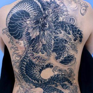 Tattoo by Oozy #Oozy #dragontattoos #blackandgrey #dragon #mythicalcreature #beast #monster #animal #waves #Japanese #illustrative #backtattoo #backpiece