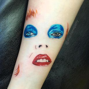 Tattoo by Shannon Perry #ShannonPerry #musictattoos #portrait #color #popart #realistic #realism #DavidBowie #famous #rip #memorial #love #singer #glam #lipstick