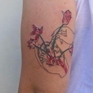 Tattoo by Mick Hee #MickHee #flowertattoos #flower #floral #tulips #heart #anatomicalheart #hand #blood #love #surreal #strange