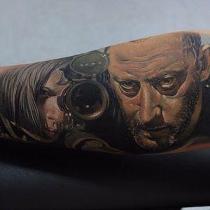 Tattoo by Sergey Shanko #SergeyShanko #leontheprofessionaltattoos #LeonTheProfessional #movietattoos #film #leon #Mathilda #gun #realism #realistic #portrait