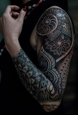 Sacred Geometry inspired sleeve including mandalas, nautilus shell and decorative elements.
