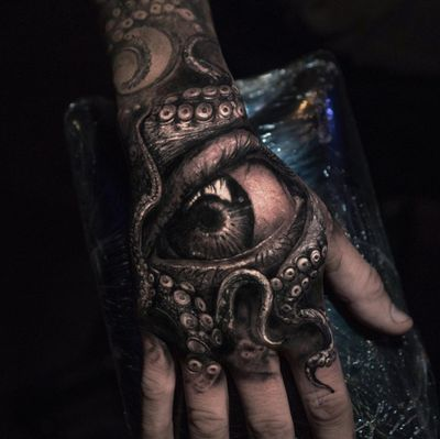 Tattoo by Yomico #Yomico #hyperrealism #realism #realistic #handtattoo #octopus #eye