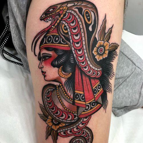 Tattoo by Rodrigo Kalaka #RodrigoKalaka #snaketattoo #color #traditional #ladyhead #lady #snake #reptile #flowers #floral #leaves #nature #cobra #animal