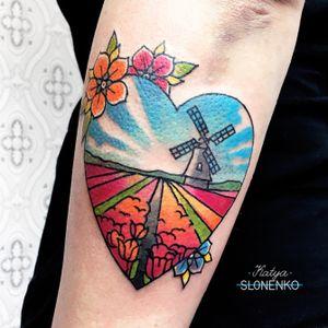 Windmill on a tulip field