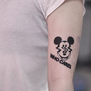Tattoo by DSMT #DSMT #MickeyMousetattoo #MickeyMouse #Disney #mouse #animal #cartoon #blackwork #text #whocares #warped