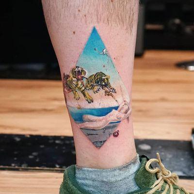 Tattoo by Ksu Arrow #KsuArrow #surrealtattoo #surreal #strange #Dali #SalvadorDali #fineart #painting #watercolor #color #dream #body #lady #tiger #gun #sky #landscape #elephant #pomegranate