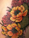 New York tattoo studio: Daredevil Tattoo NYC, done by Lara Scotton, #traditional #newyorktattoo #flowers #colorful #femaletattooartist