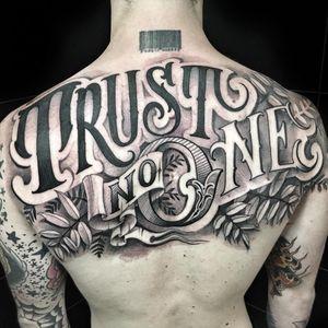 Tattoo by Delia Vico #Deliavico #letteringtattoos #lettering #text #quote #script #blackandgrey #leaves #banner #filigree