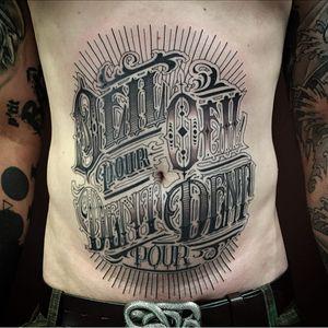 Tatto by Pierroked #pierroked #letteringtattoos #lettering #text #quote #script #blackandgrey #oldenglish #filigree #linework