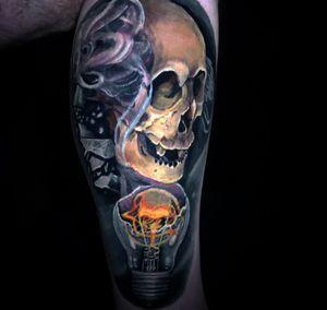 Skull with Lightbulb done @bodyartexpo on my client!