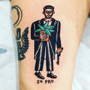 Tattoo by Wan Tattooer #WanTattooer #besttattoos #color #newschool #LeonTheProfessional #movie #movietattoo #plant #JeanReno #portrait #gun #text
